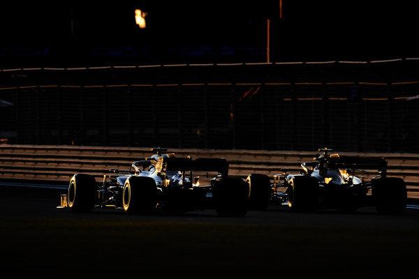 Lewis Hamilton, Mercedes AMG F1 W10, passes Kevin Magnussen, Haas VF-19