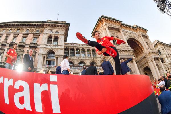 Charles Leclerc, Ferrari throws caps to the crowd