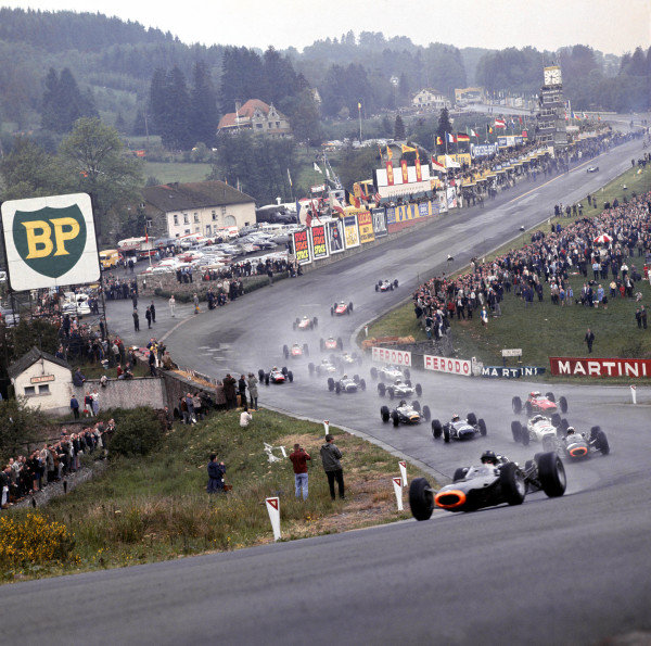1965 Belgian Grand Prix. Spa-Francorchamps, Belgium. 11-13 June 1965. Graham Hill leads Jackie Stewart (Both BRM P261's), Richie Ginther (Honda RA272), Jo Siffert (Brabham BT11 BRM), John Surtees (Ferrari 158), Dan Gurney (Brabham BT11 Climax) and the rest of the field through Eau Rouge at the start. Ref-1702. A Race Through Time exhibition number 44. World Copyright - LAT Photographic