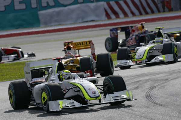Jenson Button, Brawn BGP 001 Mercedes leads Fernando Alonso, Renault R29 and Rubens Barrichello, Brawn BGP 001 Mercedes.