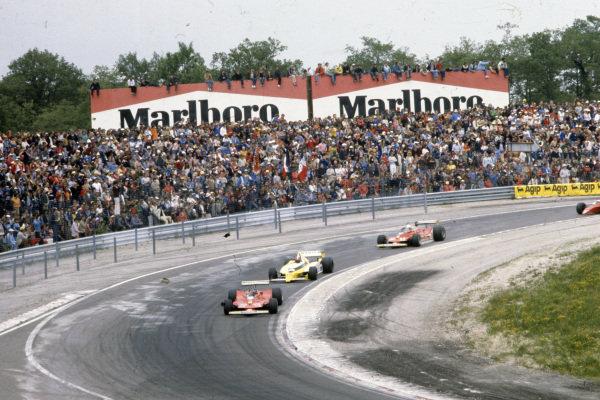 Gilles Villeneuve, Ferrari 312T4 leads Jean-Pierre Jabouille, Renault RS10 and teammate Jody Scheckter, Ferrari 312T4.