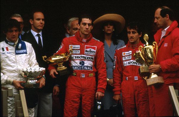 Monte Carlo, Monaco.4-7 May 1989.Ayrton Senna (McLaren Honda) 1st position, Alain Prost (McLaren Honda) 2nd position and Stefano Modena (Brabham BT58 Judd) 3rd position celebrate on the podium. McLaren team boss Ron Dennis on the far right.Ref-89 MON 01.World Copyright - LAT Photographic