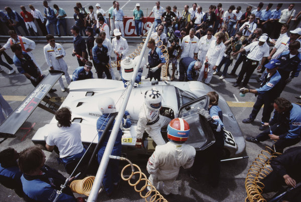 Jean-Louis Schlesser / Jean-Pierre Jabouille / Alain Cudini, Team Sauber Mercedes, Sauber-Mercedes C9/88, pit stop. Schlesser exits the car, as Jabouille stands upright.