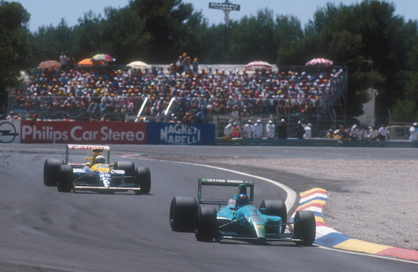 1990 French Grand Prix.Paul Ricard, Le Castellet, France. 6-8 July 1990.Ivan Capelli (Leyton House CG901 Judd) takes the lead of the race for the first time, with Riccardo Patrese (Williams FW13B Renault) lying 2nd behind him. Ref-90 FRA 23.World Copyright - LAT Photographic