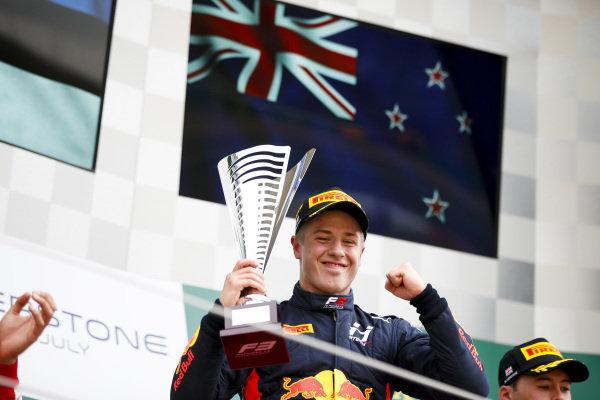 Race winner Juri Vips (EST) Hitech Grand Prix celebrates on the podium with the trophy