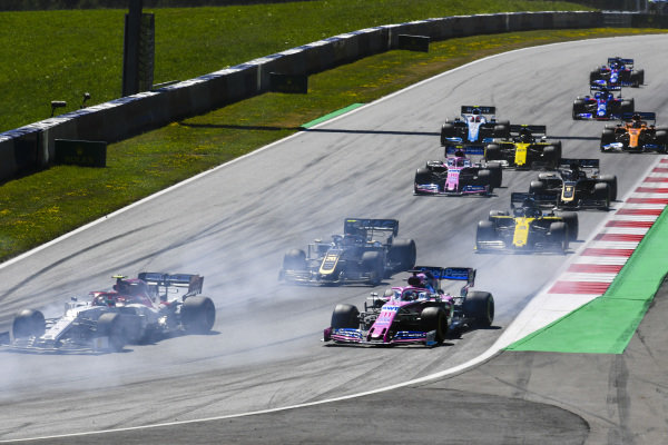 Antonio Giovinazzi, Alfa Romeo Racing C38, leads Sergio Perez, Racing Point RP19, Kevin Magnussen, Haas VF-19, Daniel Ricciardo, Renault R.S.19, Sergio Perez, Racing Point RP19, and the remainder of the field at the start