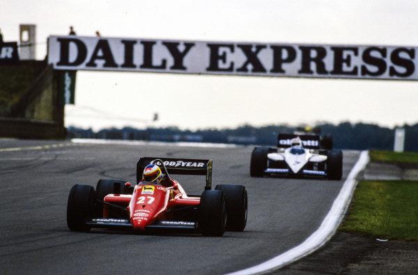 Michele Alboreto, Ferrari 156/85, leads Nelson Piquet, Brabham BT54 BMW.