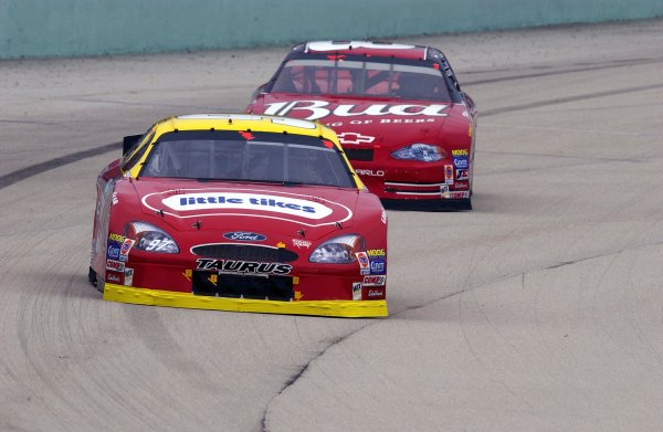 NASCAR Winton Cup Ford 400, Homestead-Miami Speedway, Homestead, Florida, USA 17 November,2002 Kurt Busch leads Dale Earnhardt,Jr. early in the race.Copyright-F Peirce Williams/MMP-Inc. 2002 LAT Photographic