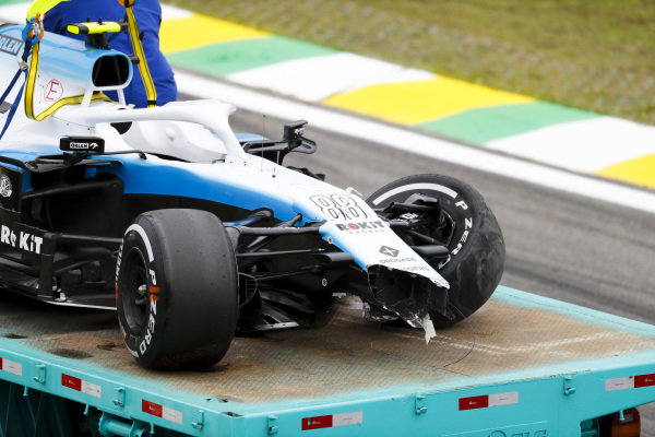 Car of Robert Kubica, Williams FW42 being recovered on a low loader