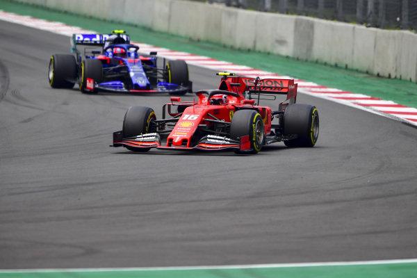 Charles Leclerc, Ferrari SF90 and Pierre Gasly, Toro Rosso STR14