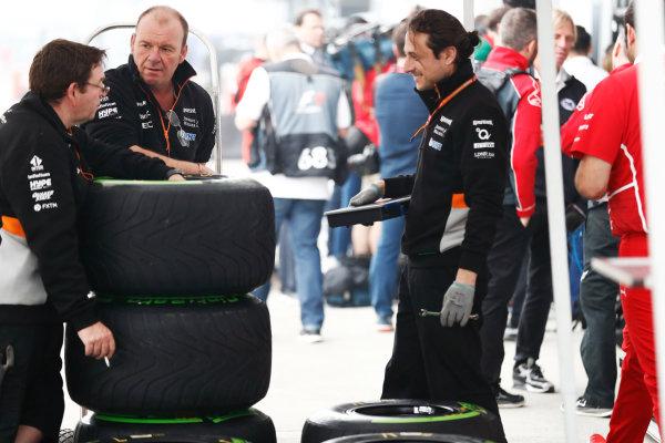 Shanghai International Circuit, Shanghai, China.  Thursday 06 April 2017. Force India team members next to a stack of Pirelli intermediate tyres. World Copyright: Glenn Dunbar/LAT Images ref: Digital Image _X4I4841