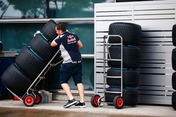Shanghai International Circuit, Shanghai, China.  Thursday 06 April 2017. A Red Bull team member wheels a stack of Pirelli tyres. World Copyright: Andy Hone/LAT Images ref: Digital Image _ONY3429