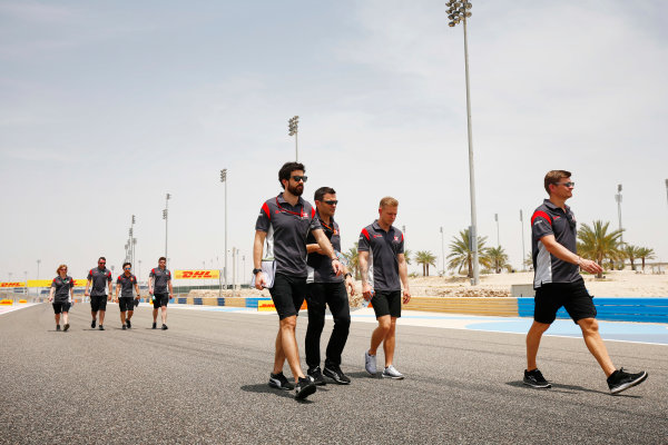 Bahrain International Circuit, Sakhir, Bahrain.  Thursday 13 April 2017. Kevin Magnussen, Haas F1, walks the track with his team. World Copyright: Andy Hone/LAT Images ref: Digital Image _ONY6116