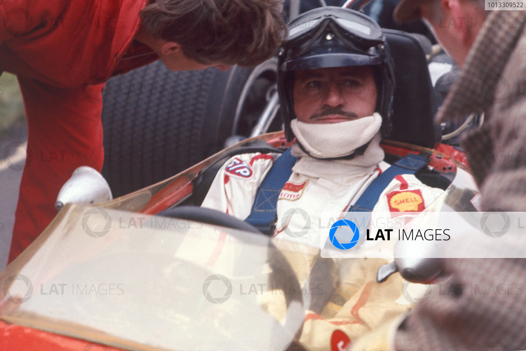 Graham Hill sits in his Lotus before the race. Portrait.World- LAT Photographic.