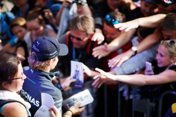 Red Bull Ring, Spielberg, Austria. Saturday 21 June 2014. Nico Rosberg, Mercedes AMG, signs autographs for fans. World Copyright: Charles Coates/LAT Photographic. ref: Digital Image _N7T3546
