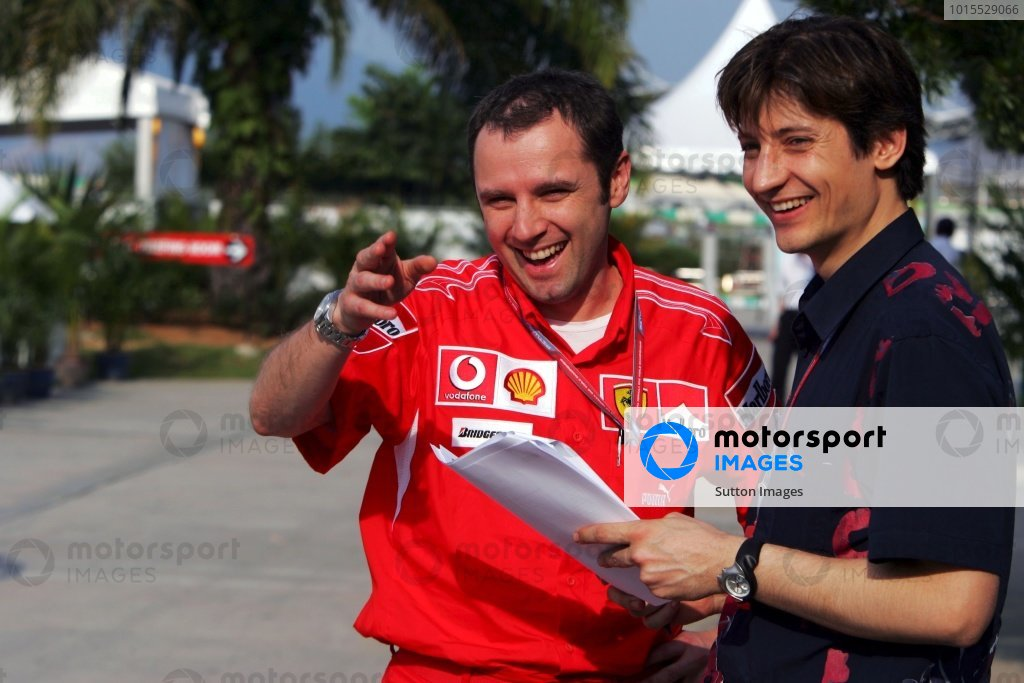 (L to R): Stefano Domenicali (ITA) Ferrari Manager of F1 Operations talks with Massimo Rivola (ITA) Scuderia Toro Rosso Team Manager. Formula One World Championship, Rd 2, Malaysian Grand Prix, Practice, Sepang, Malaysia, 17 March 2006.  DIGITAL IMAGE