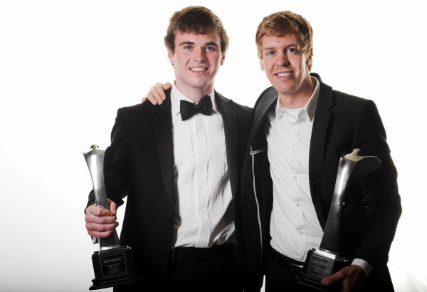 Grosvenor House Hotel, Park Lane, London 4th December 2011 Sebastian Vettel with his International Racing Driver of the Year trophy and McLaren Autosport BRDC Young Driver of the Year Award winner Oliver Rowland and his trophy. Portrait.World Copyright: Malcolm Griffiths/LAT Photographic ref: Digtal Image MG5D7479