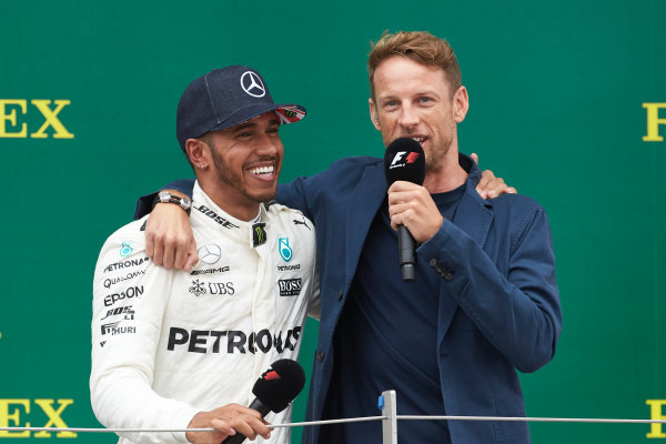 Silverstone, Northamptonshire, UK.  Sunday 16 July 2017. Lewis Hamilton, Mercedes AMG, andJenson Button, McLaren, on the podium. World Copyright: Steve Etherington/LAT Images  ref: Digital Image SNE10208