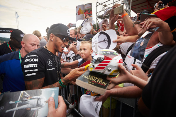 Spa-Francorchamps, Spa, Belgium. Thursday 20 August 2015. Lewis Hamilton, Mercedes AMG, signs autographs for fans. World Copyright: Steve Etherington/LAT Photographic ref: Digital Image SNE15042