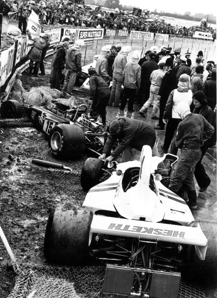 1975 British Grand Prix.Silverstone, Great Britain. 17-19 July 1975.The crashed cars of James Hunt (#24 Hesketh 308-Ford Cosworth), Brian Henton (#15 Lotus 72E-Ford Cosworth) and Carlos Pace (Brabham BT44B-Ford Cosworth). Heavy rain caused the race to be stopped early. Accident.World Copyright: LAT PhotographicRef: 7732#37