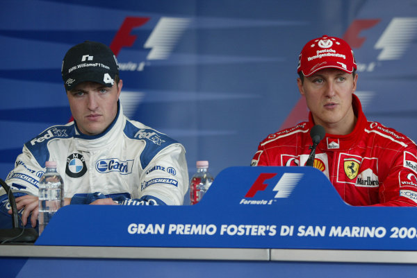 2003 San Marino Grand Prix - Saturday Final Qualifying,Imola, Italy. 19th April 2003 Ralf Schumacher, BMW Williams FW25, and brother Michael Schumacher, Ferrari F2002, at the press conference.World Copyright: Steve Etherington/LAT Photographic ref: Digital Image Only