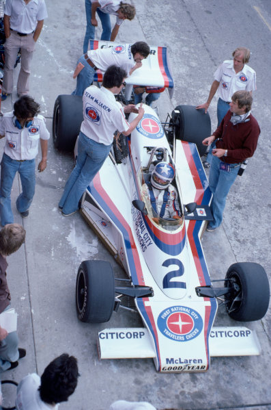 1977 USAC Indycar Series.Mosport Park, Canada. 3rd July 1977.Johnny Rutherford (McLaren-Cosworth), 9th position, pit stop action as Tyler Alexander looks on.World Copyright: Murenbeeld/LAT Photographic