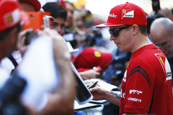 Circuit de Catalunya, Barcelona, Spain. Thursday 8 May 2014. Kimi Raikkonen, Ferrari, signs autographs for fans. World Copyright: Andy Hone/LAT Photographic. ref: Digital Image _ONY7753