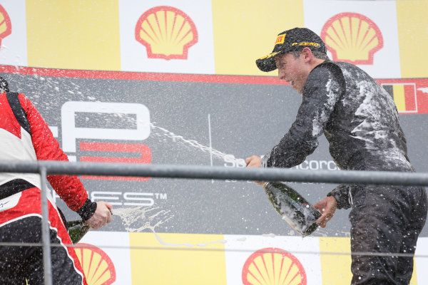 2013 GP3 Series. Round 6.  Spa - Francorchamps, Spa, Belgium. 25th August. Sunday Race. Alexander Sims (GBR, Carlin) celebrates his victory on the podium.  World Copyright: Alastair Staley/GP3 Media Service. ref: Digital Image _R6T8345.jpg