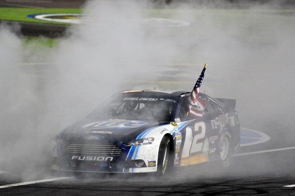 10-12 October, 2013, Concord, North Carolina USA Brad Keselowski celebrates his win with a burnout ©2013, Nigel Kinrade LAT Photo USA