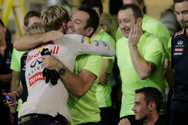 Yas Marina Circuit, Abu Dhabi, United Arab Emirates. Sunday 3rd November 2013. Sebastian Vettel, Red Bull Racing, 1st position, celebrates with his team. World Copyright: Andy Hone/LAT Photographic. ref: Digital Image _ONY1747