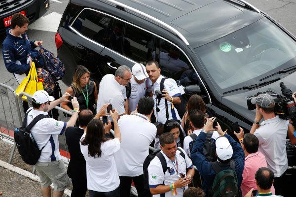 Interlagos, Sao Paulo, Brazil. Sunday 9 November 2014. Felipe Massa, Williams F1, poses for photos with fans. World Copyright: Charles Coates/LAT Photographic. ref: Digital Image _J5R5286