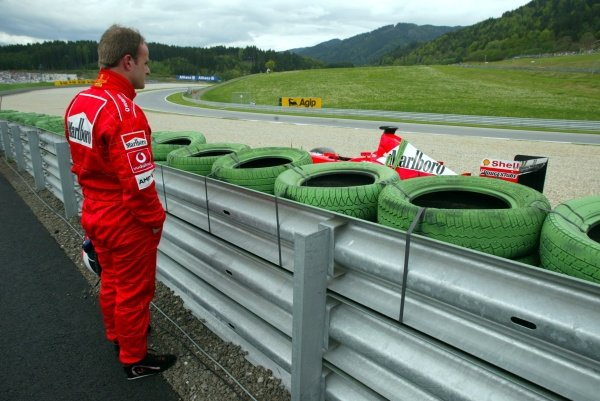Rubens Barrichello (BRA) Ferrari F2002 watches from the barriers after spinning out in first practice. Austrian Grand Prix, A1-Ring, 10 May 2002. DIGITAL IMAGE