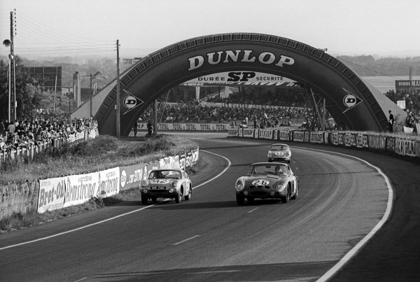 The Ferrari 250 GTO/LM of Masten Gregory (USA) / David Piper (GBR) laps the Austin Healey Sprite of John Whitmore (GBR) / Bob Olthoff (GBR). The Ferrari would finish in 6th position. Le Mans 24 Hours, Le Mans, France, 16-17 June 1963.