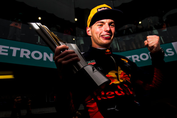 Sepang International Circuit, Sepang, Malaysia. Sunday 1 October 2017. Max Verstappen, Red Bull, 1st Position, celebrates with his team and his trophy. World Copyright: Zak Mauger/LAT Images  ref: Digital Image _56I3713