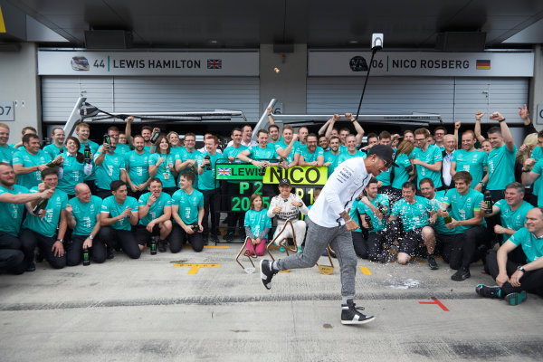 Red Bull Ring, Spielberg, Austria. Sunday 21 June 2015. Nico Rosberg, Mercedes AMG, 1st Position, and Lewis Hamilton, Mercedes AMG, 2nd Position, celebrate with the Mercedes AMG team. World Copyright: Steve Etherington/LAT Photographic. ref: Digital Image SNE14900
