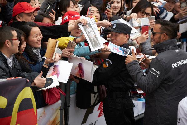 Shanghai International Circuit, Shanghai, China. Thursday 9 April 2015. Lewis Hamilton, Mercedes AMG signs autographs for fans. World Copyright: Steve Etherington/LAT Photographic. ref: Digital Image SNE26833