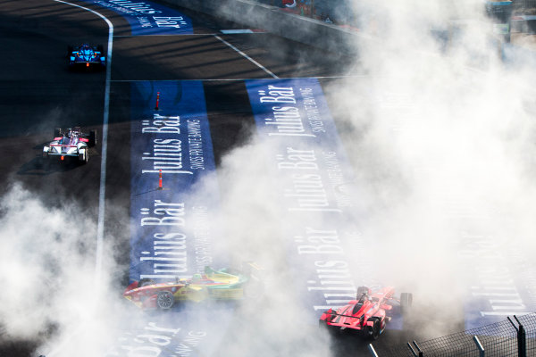 2015/2016 FIA Formula E Championship. Mexico City ePrix, Autodromo Hermanos Rodriguez, Mexico City, Mexico. Saturday 12 March 2016. Lucas Di Grassi (BRA), ABT Audi Sport FE01 and Jerome D'Ambrosio (FRA) Dragon Racing - Venturi VM200-FE-01 celebrate by performing donuts for the crowds. Photo: Zak Mauger/LAT/Formula E ref: Digital Image _79P3816