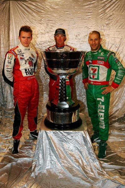 L-R: The 2004 IRL title contenders; Dan Wheldon (GBR), Andretti Green Racing; Buddy Rice (USA) Rahal Letterman Racing; Tony Kanaan (BRA), Andretti Green Racing. Kanaan won the championship. IRL IndyCar Series, Rd15, Toyota 400, California Speedway, Fontana, California, 1-3 October 2004. DIGITAL IMAGE