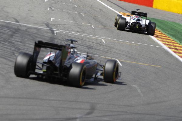 Spa-Francorchamps, Spa, Belgium. Sunday 24 August 2014. Felipe Massa, Williams FW36 Mercedes, leads Adrian Sutil, Sauber C33 Ferrari. World Copyright: Sam Bloxham/LAT Photographic. ref: Digital Image _G7C7515