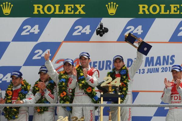 Circuit de La Sarthe, Le Mans, France. 6th - 13th June 2010.Mike Rockenfeller / Timo Bernhard / Romain Dumas, Audi Sport North America, No 9 Audi R15-Plus TDI, celebrate on the podium. Portrait. Podium. World Copyright: Jeff Bloxham/LAT PhotographicDigital Image DSC_1708 JPG