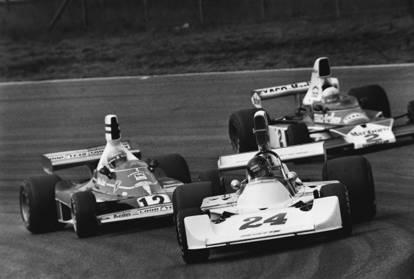 Zandvoort, Holland.  20-22 June 1975. James Hunt (Hesketh 308-Ford), 1st position, leads Niki Lauda (Ferrari 312T), 2nd position and Jochen Mass (McLaren M23-Ford), retired, action. World Copyright: LAT Photographic.Ref:  L75 - 1544 - 24A.