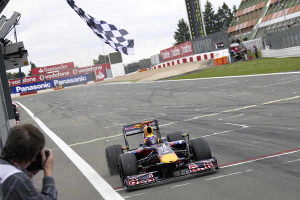 Mark Webber, Red Bull RB5 Renault takes the chequered flag for his first victory.