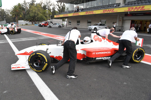 Patrick Friesacher (AUT) F1 Experiences 2-Seater driver and F1 Experiences 2-Seater passenger Juanpa Zurita (MEX) at Formula One World Championship, Rd18, Mexican Grand Prix, Qualifying, Circuit Hermanos Rodriguez, Mexico City, Mexico, Saturday 28 October 2017.