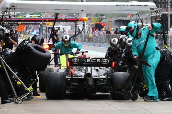 Sir Lewis Hamilton, Mercedes W12, makes a stop
