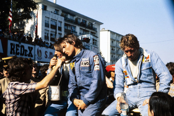 René Arnoux, 1st position, is interviewed after the race. Jacques Laffite, 2nd position, and Jean-Pierre Jabouille, 3rd position, are alongside.