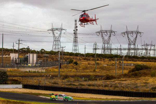 Daniel Ricciardo tests Kelly Racing Nissan Supercar at Calder. A helicopter flies over pylons