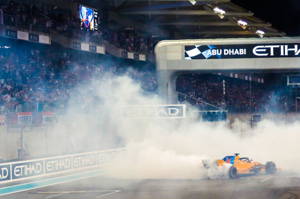 Fernando Alonso, McLaren MCL33, performs donuts after completing his final race in F1
