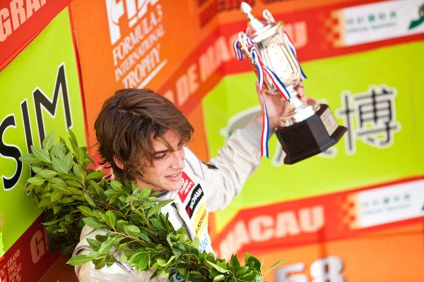 Formula Three. 16th - 19th November 2011. Circuit de Guia, Macau. Roberto Merhi, Prema Powerteam celebrates on the podium after the qualifying race. Portrait. World Copyright: Drew Gibson/LAT Photographic. ref: Digital Image _Y2Z6361