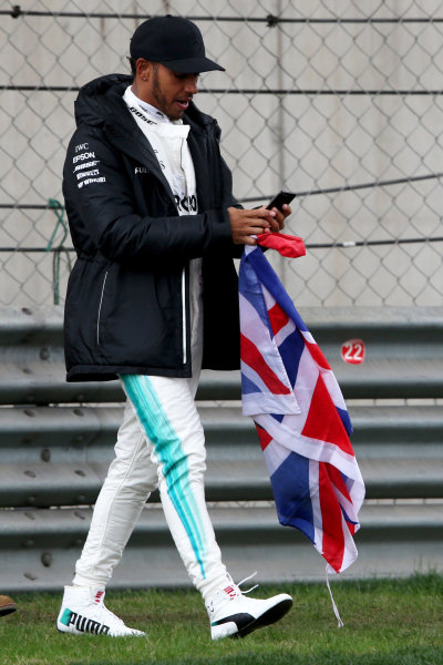 Shanghai International Circuit, Shanghai, China.  Friday 07 April 2017.  Lewis Hamilton, Mercedes AMG, takes to the track to entertain the fans and picks up a Union Flag. World Copyright: Charles Coates/LAT Images  ref: Digital Image AN7T4839