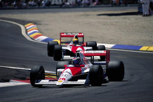 Gerhard Berger, McLaren MP4-5B Honda, leads team-mate Ayrton Senna.